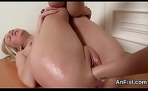 Foxy lesbian tow-haired are stretching and fist fucking assholes