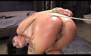 Long haired babe caned and finger screwed